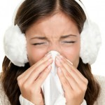Flu or cold sneezing woman